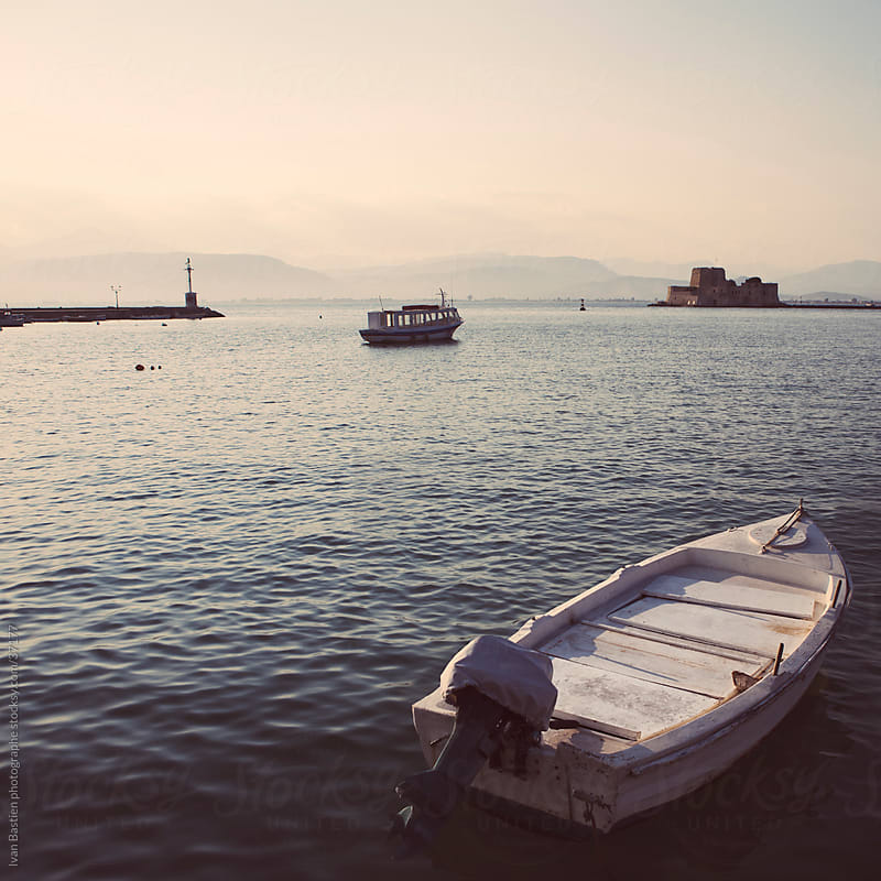 Boats in Nafplio harbour by Ivan Bastien for Stocksy United