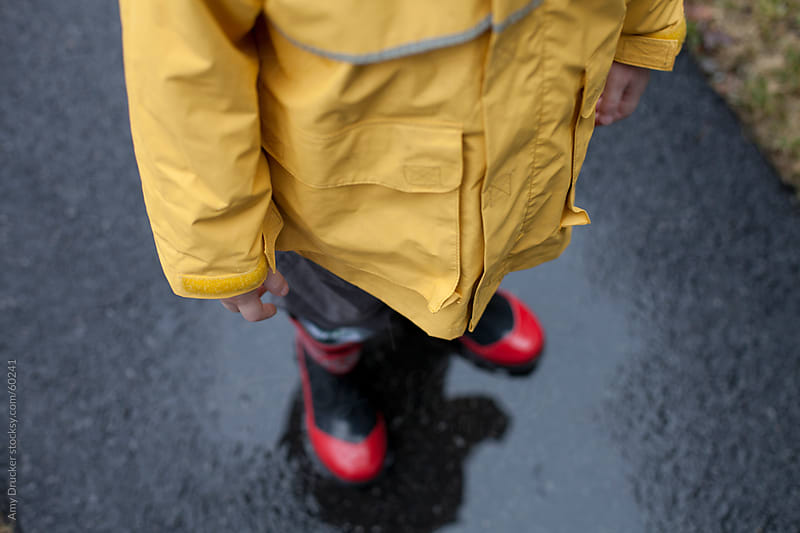 Child in Yellow Raincoat by Amy Drucker for Stocksy United