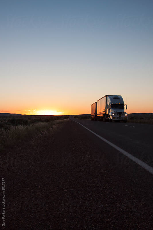A road train driving in Australian outback by Gary Parker for Stocksy United