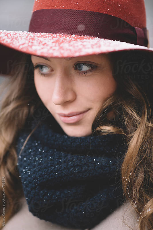 portrait of young woman with hat on the street  by Alexey Kuzma for Stocksy United