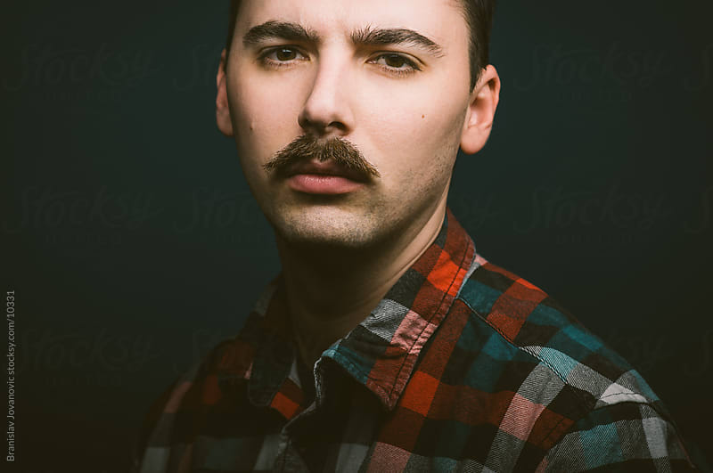 Portrait of a real man with mustaches by Branislav Jovanović for Stocksy United