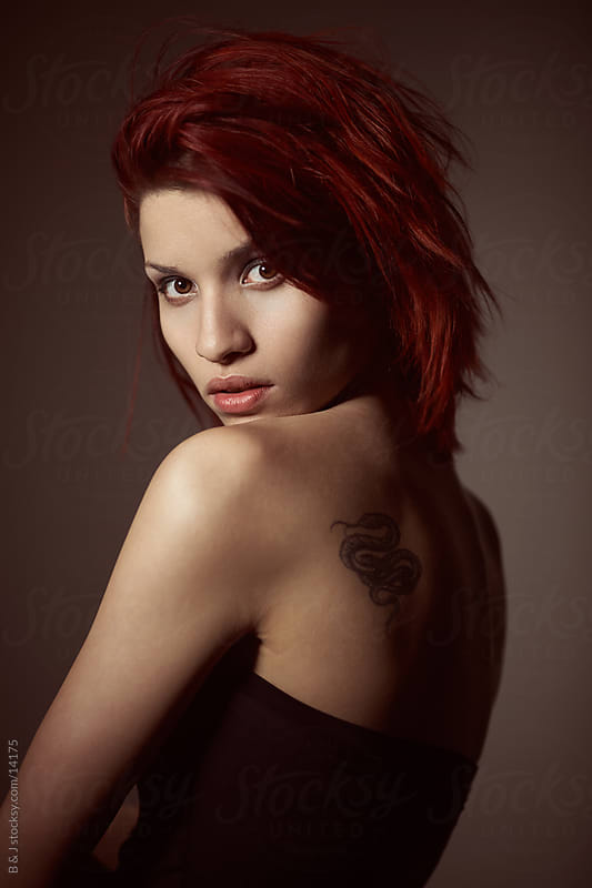 portrait of a girl with a tattoo by B & J for Stocksy United