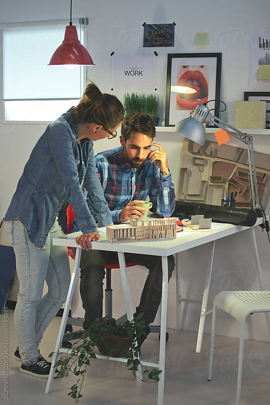 Two young architects working together in the office. Creative team. by BONNINSTUDIO for Stocksy United