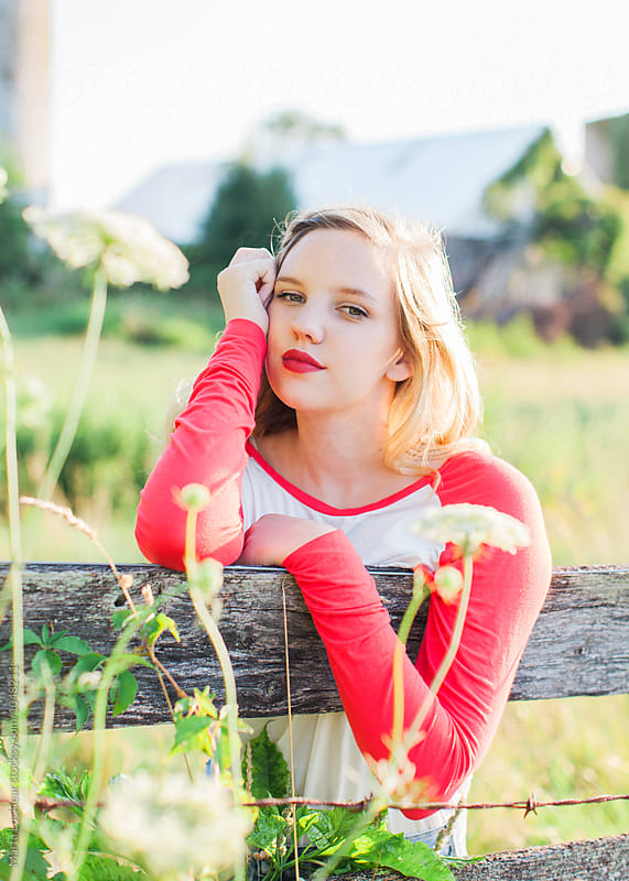 Teen Portrait at a fence by Marta Locklear for Stocksy United