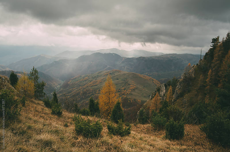 Mountain landscape with heavy storm clouds by Cosma Andrei for Stocksy United