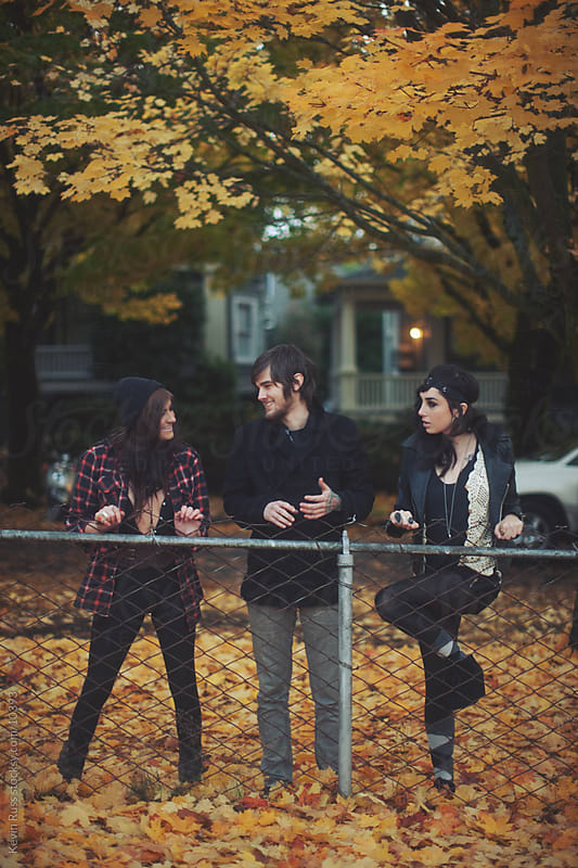 People By Fall Fence by Kevin Russ for Stocksy United