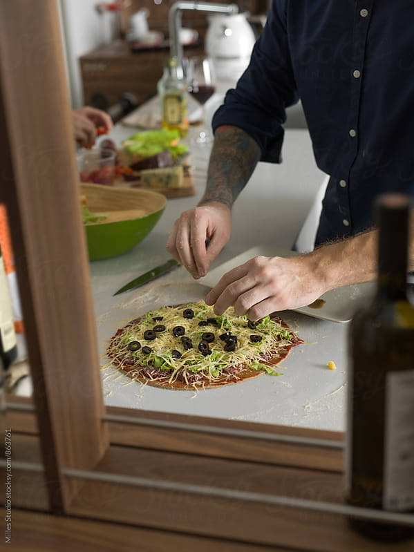 Man cooking homemade pizza by Milles Studio for Stocksy United