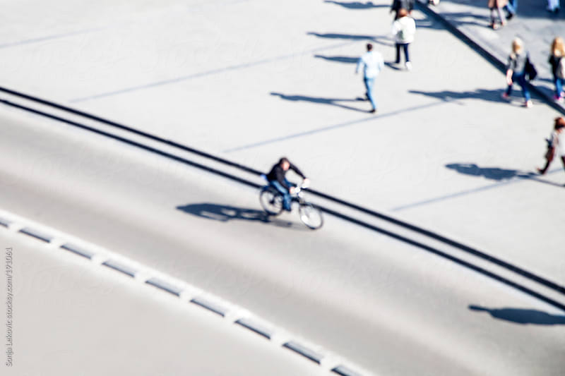 people in the street from above defocused by Sonja Lekovic for Stocksy United