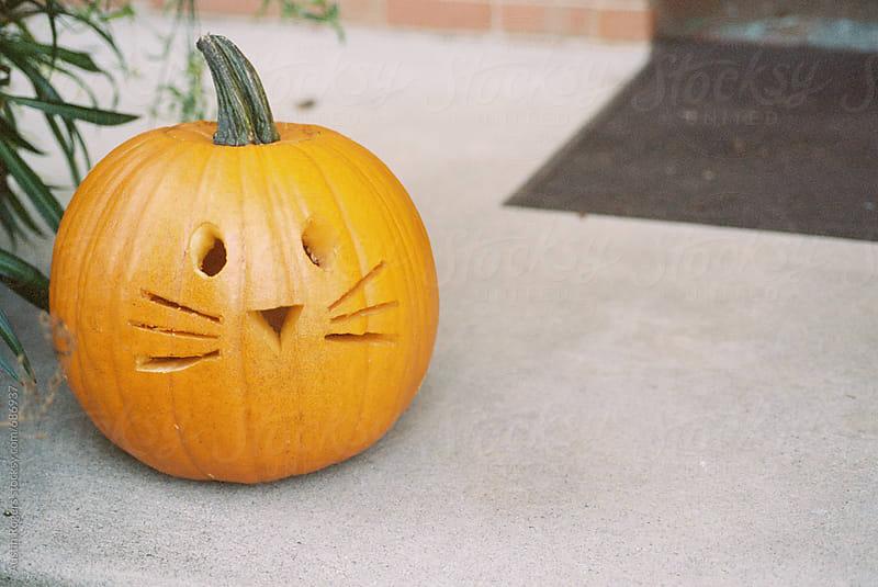 Carved Pumpkin on Door Stoop by Austin Rogers for Stocksy United