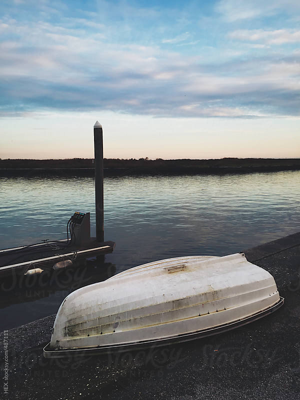 Disused Boat on a Peer by HEX. for Stocksy United