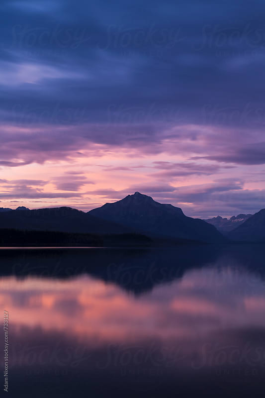Sunset on Lake McDonald, Glacier NP by Adam Nixon for Stocksy United