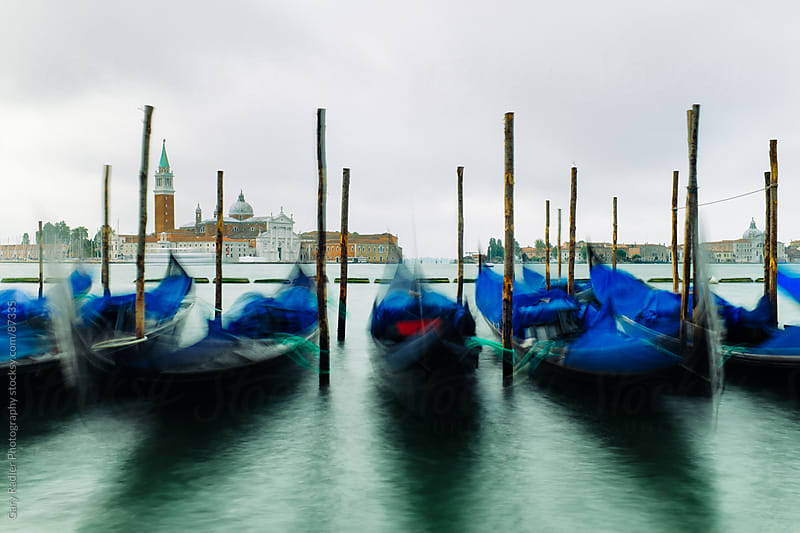 Venice gondolas with Church of San Giorgio Maggiore in background by Gary Radler Photography for Stocksy United