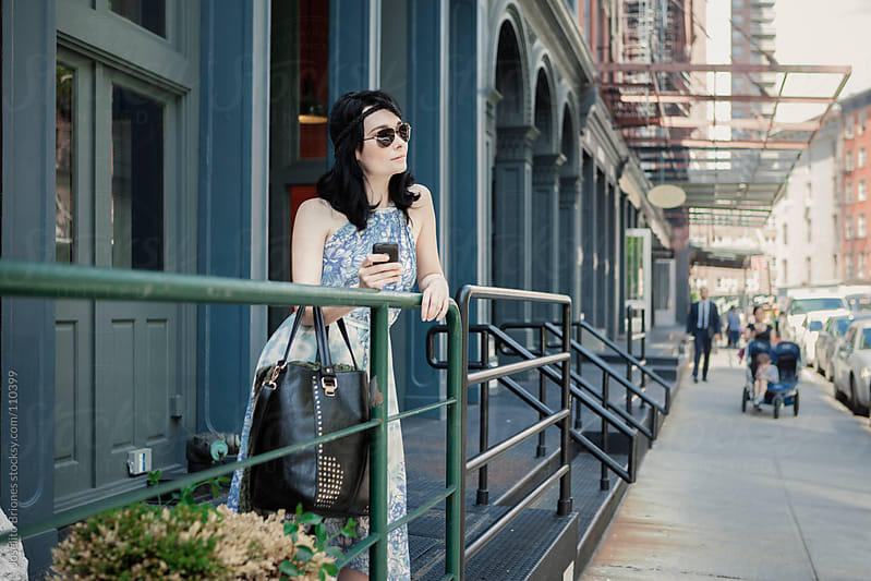 Woman in Floral Dress and Aviator Sunglasses in Tribeca New York by Joselito Briones for Stocksy United