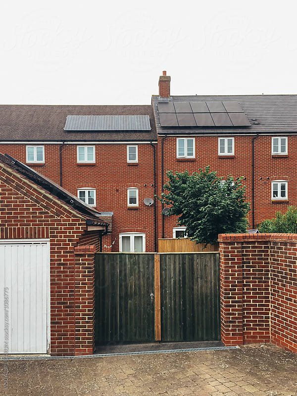 Roof-Mounted Solar Panels on Exposed Brick Building in United Kingdom by VISUALSPECTRUM for Stocksy United