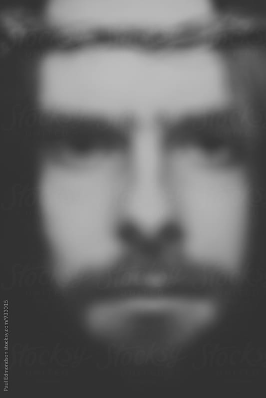Close up of man resembling Jesus Christ, blurred focus by Paul Edmondson for Stocksy United
