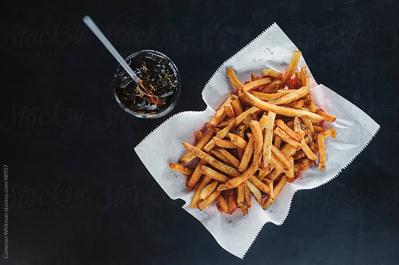 Bar Food: French Fries and Cola by Cameron Whitman for Stocksy United