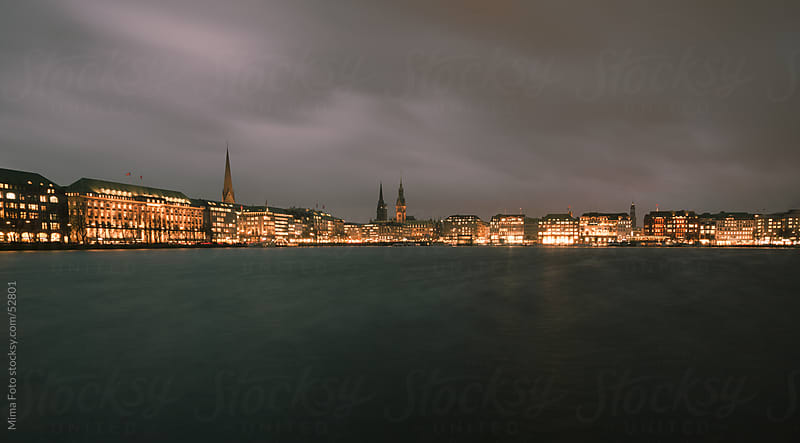 Early night view across Binnenalster to Hamburg, Germany by Mima Foto for Stocksy United