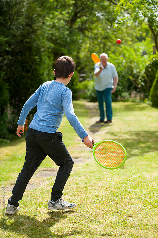 grandfather and grandson playing tennis