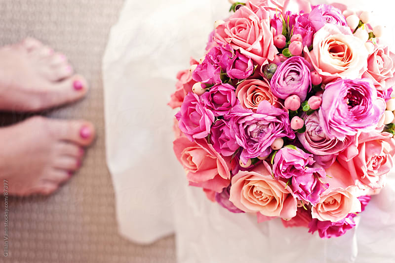 bride's bouquet with feet by Gillian Vann for Stocksy United