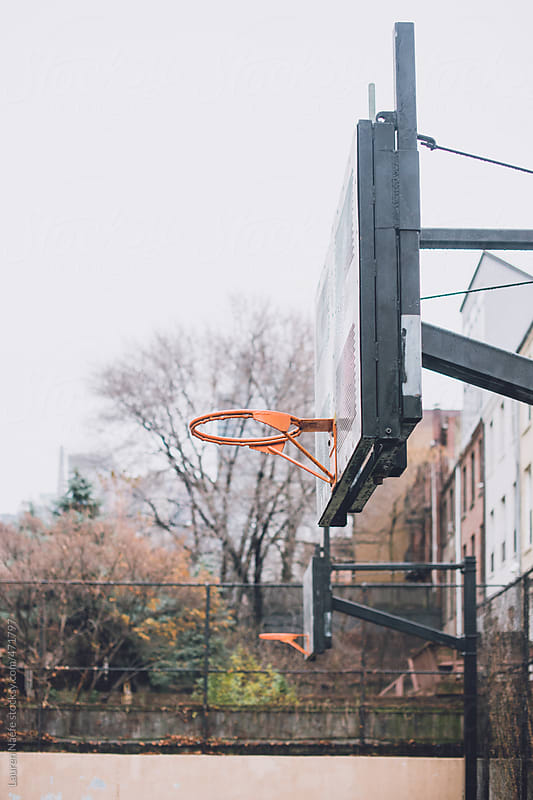 Basketball hoop in the rain by Lauren Naefe for Stocksy United
