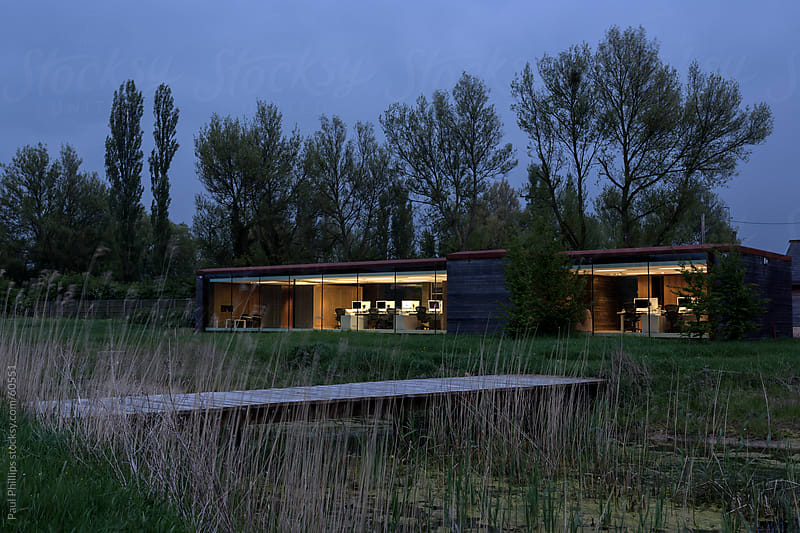 Eco-friendly office building at twilight by Paul Phillips for Stocksy United