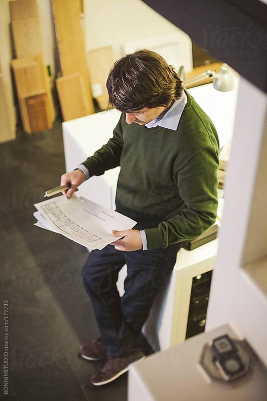 Interior designer man working in his studio.  by BONNINSTUDIO for Stocksy United