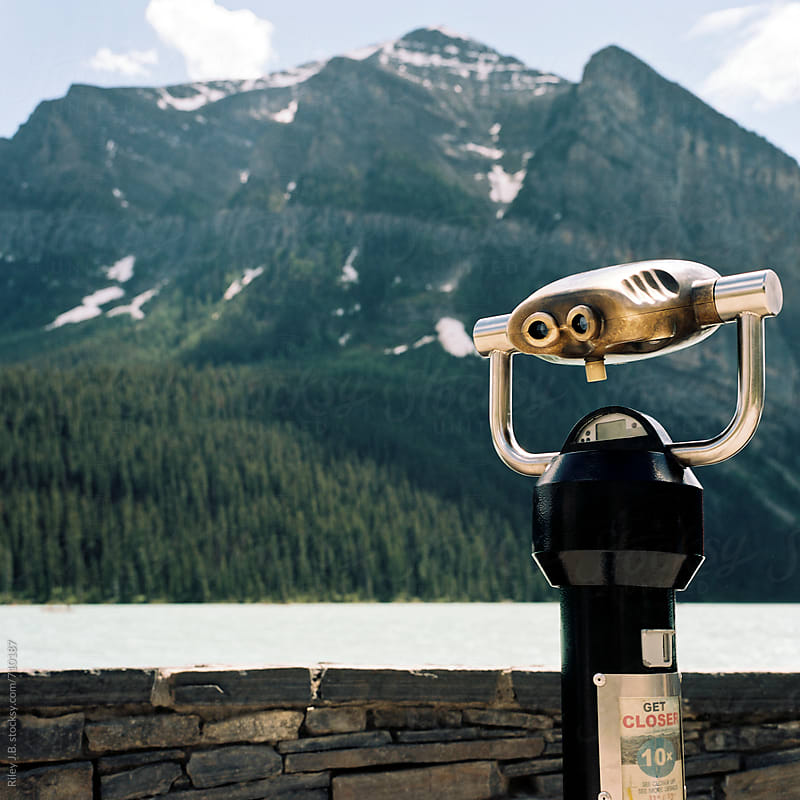 Coin-Operated binoculars at scenic mountain outlook by Riley J.B. for Stocksy United