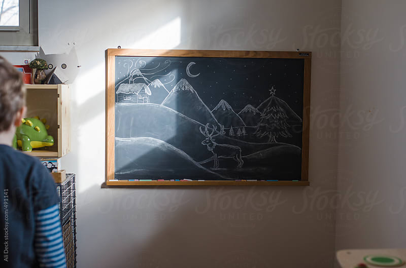Toddler and Chalk Board by Ali Deck for Stocksy United