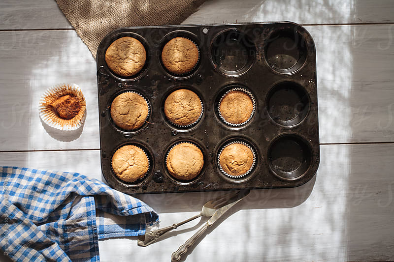 Freshly baked muffins. by Darren Muir for Stocksy United
