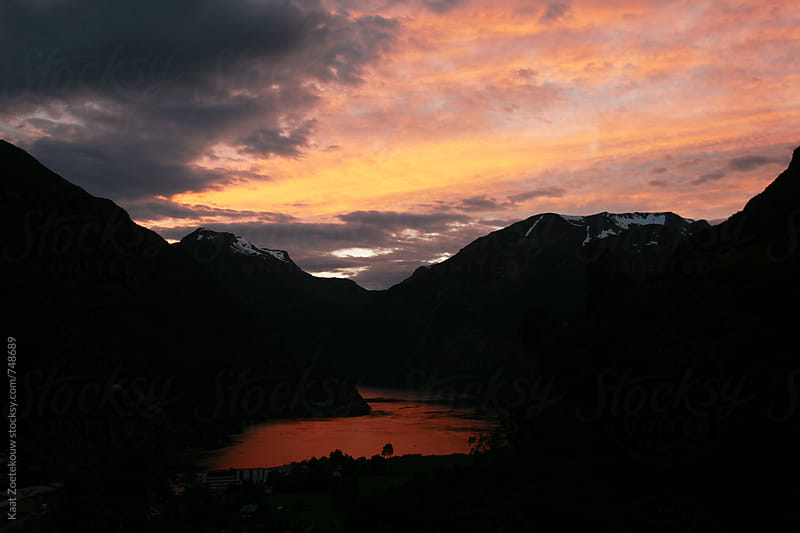 Sunset over Geirangerfjord by Kaat Zoetekouw for Stocksy United