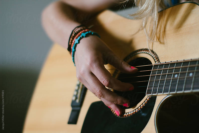 A girl and a guitar by Jacqui Miller for Stocksy United
