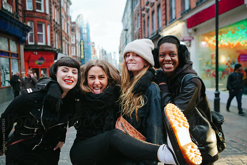 Group of young women having fun around London by kkgas for Stocksy United