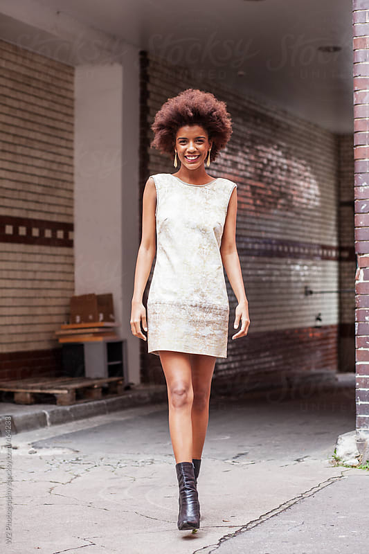 Streetstyle model in a summer dress walking  by W2 Photography for Stocksy United