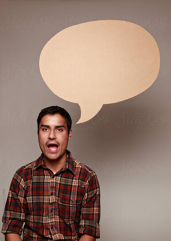 man with speech bubble by Brian Powell for Stocksy United