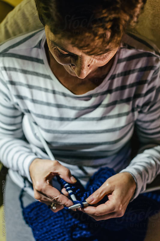 Senior Woman Knitting at Her Home by VICTOR TORRES for Stocksy United