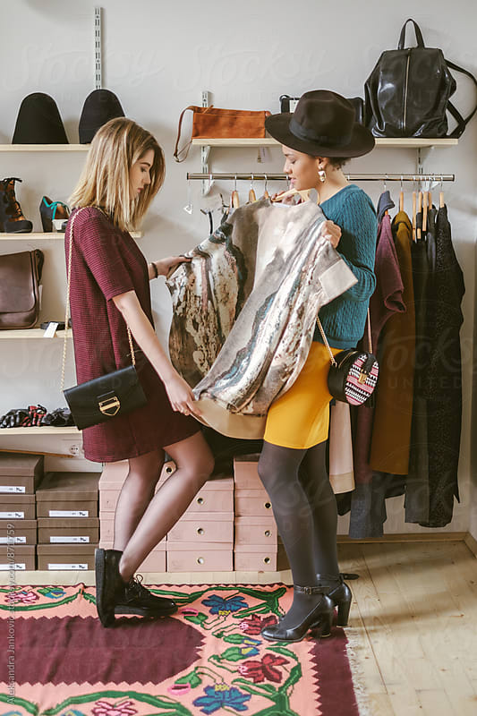 Two Female Friends Shopping in the Clothing Store by Aleksandra Jankovic for Stocksy United