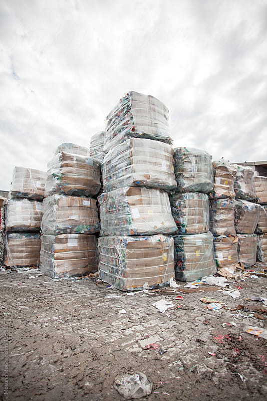 Pallets of Old Paper Outside Recycle Factory by Mosuno for Stocksy United