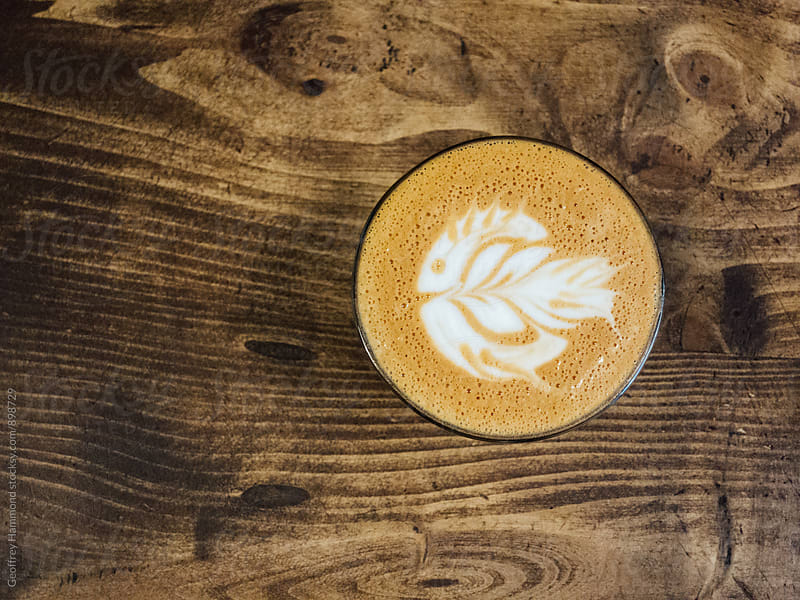 Fish Latte Art on Wooden Counter by Geoffrey Hammond for Stocksy United