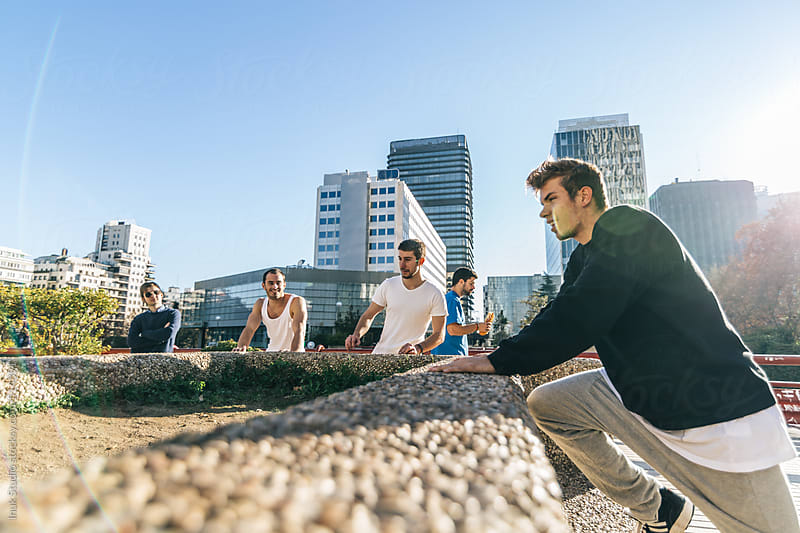 Group of men resting during a parkour training by Inuk Studio for Stocksy United