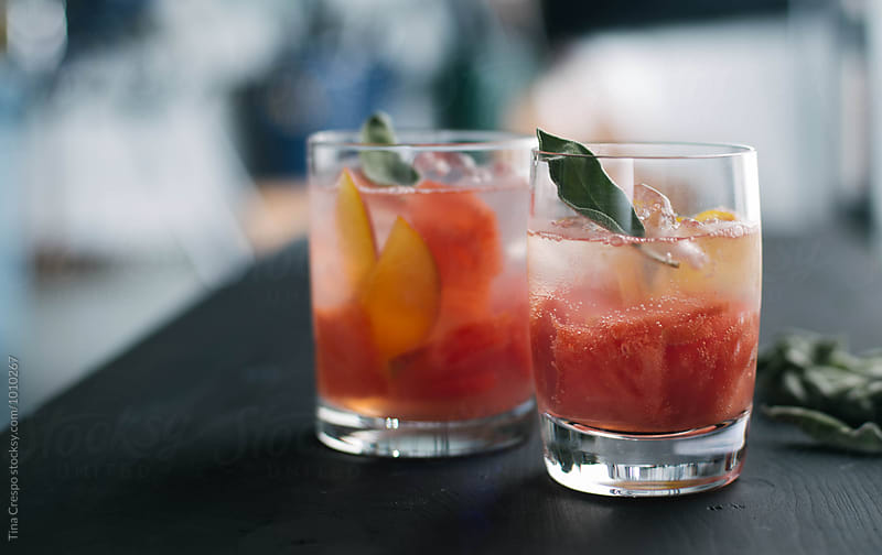 Peach and Watermelon Cocktail by Tina Crespo for Stocksy United