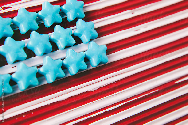 Handmade usa flag with sugar stars and painted red background. by BONNINSTUDIO for Stocksy United