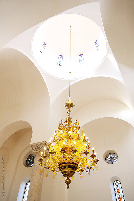 church ceiling with chandelier by Sonja Lekovic for Stocksy United