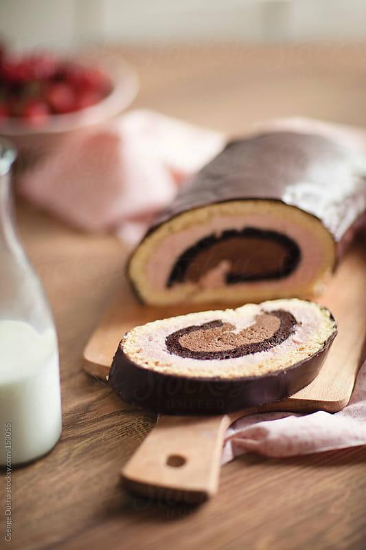 Strawberry-chocolate roualde by Csenge Dusha for Stocksy United
