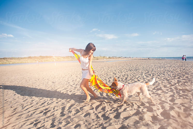 Girl and dog by Carlo Amoruso for Stocksy United