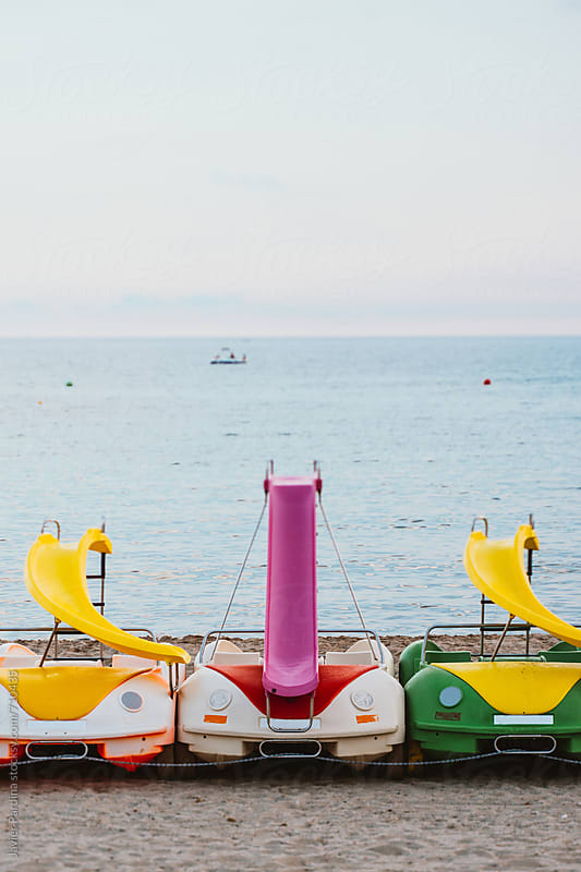 boats car parking on the beach by Javier Pardina for Stocksy United