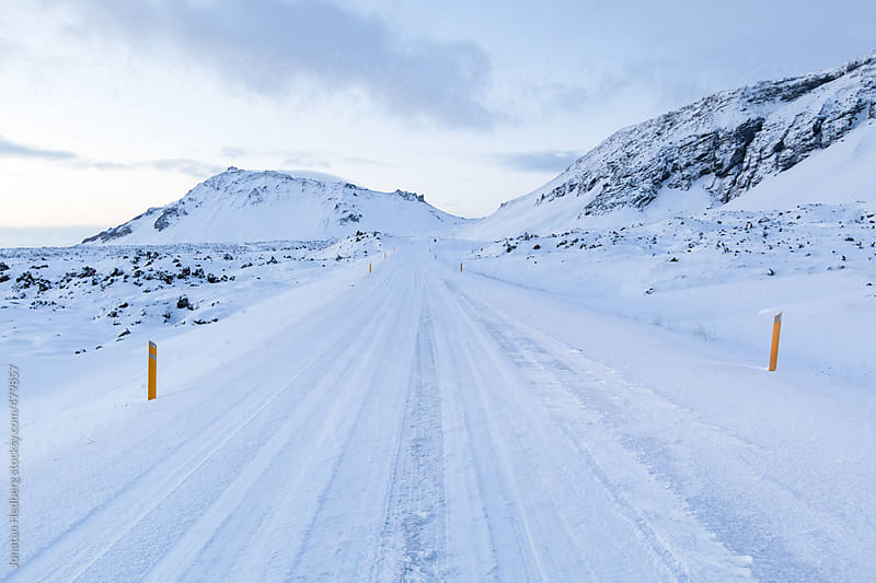 An empty road in the winter by Jonatan Hedberg for Stocksy United
