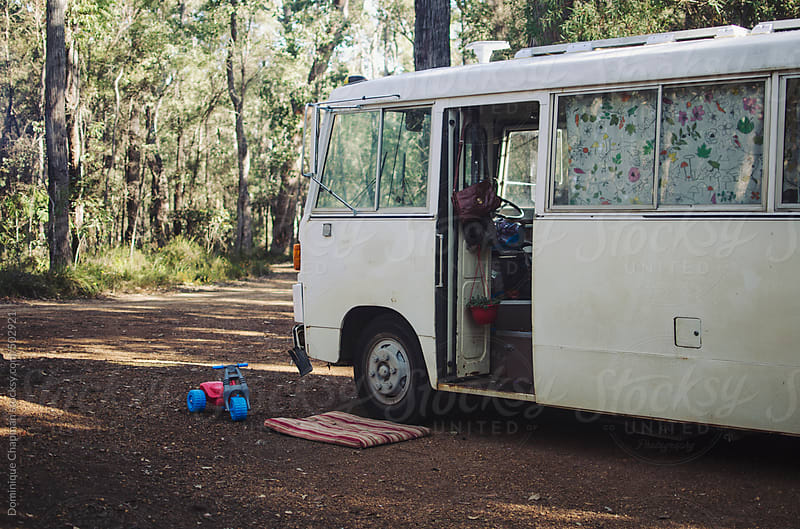Motorhome camped out in Forest by Dominique Chapman for Stocksy United