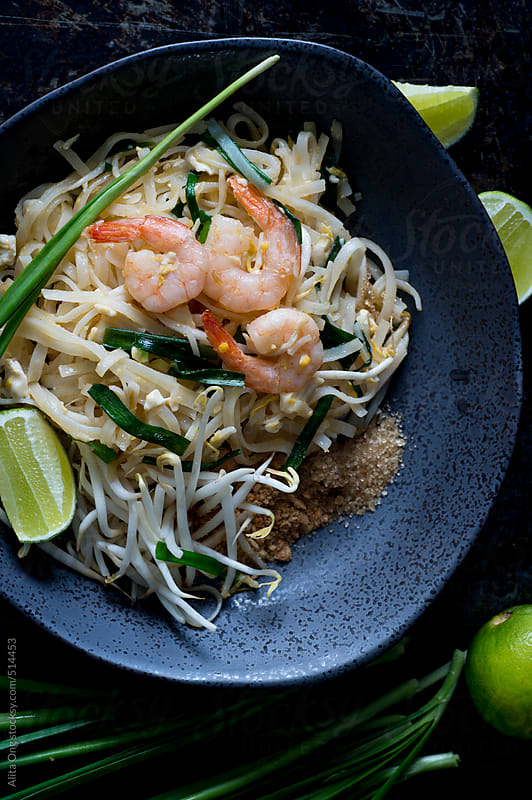 Pad thai on dark background by Alita Ong for Stocksy United