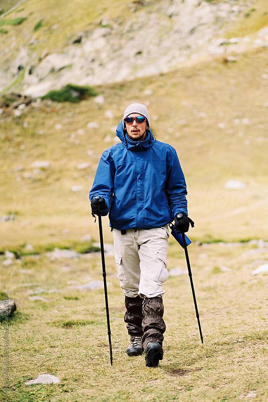 Young hiker walking by Marko Milovanović for Stocksy United