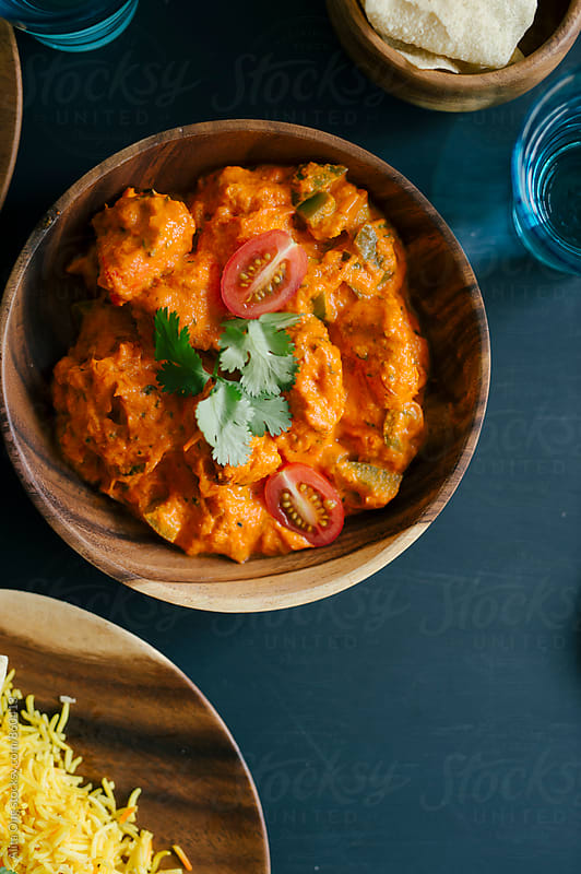Chicken tikka masala by Alita Ong for Stocksy United